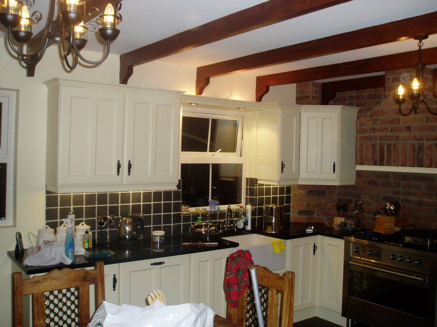 The cabinets in this kitchen had been plain pine and has been transformed with some ESP and a lick of paint